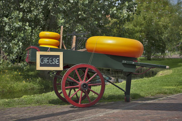 Carriage with cheese and a weighing machine