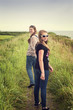 Two pretty teenagers walking on a dike