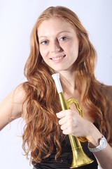 Pretty redhead woman with a trumpet