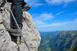 Bergschuhe als Detail am Klettersteig