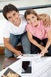 Happy Couple With House Plan