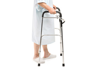 An old patient using a walker