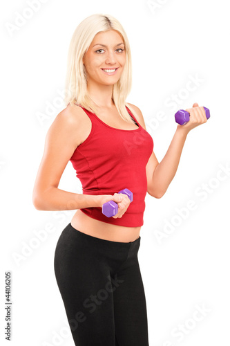Attractive young woman exercising with weights