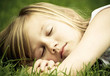 Girl asleep outdoors