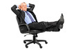 Mature businessman resting in armchair with legs up