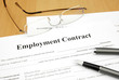 employment contract form on a desk