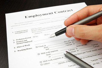 employment contract form with human hand