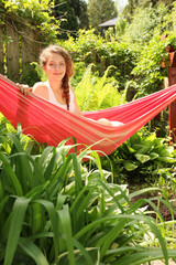 Girl sit in a hammock