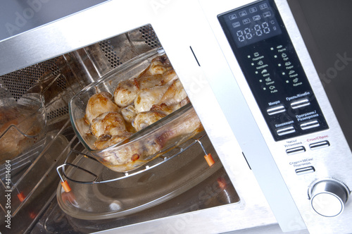 Chicken legs on a glass dish in the convection oven