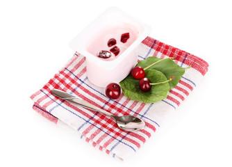 Yogurt with cherry isolated on white