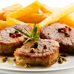 Grilled steaks with French fries