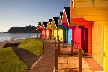 Beach huts at sunrise in Great Britain