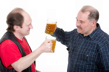 Elderly men holding a beer belly and sausage