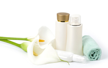Beauty spa lotions, white calla and towel on white background