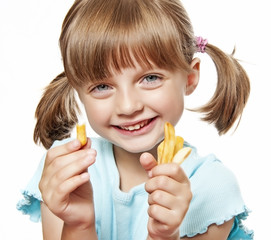 happy little girl eating a french fries