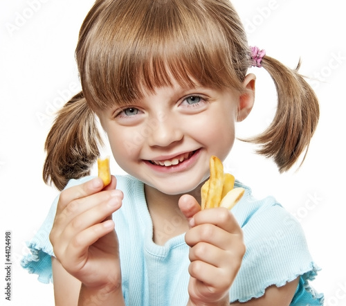 happy little girl eating a french fries - 44124498