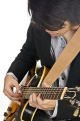 Asian young musician playing guitar
