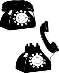 rotary telephone on the hook and off over white