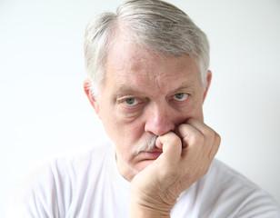 senior man looking very bored