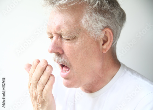 older man's expression just before he sneezes