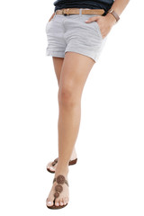 Woman legs with hot pants on white background