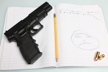 Automatic Pistol with loose ammunition & pencil on comp book