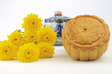 Moon cakes and  tea decorated with chrysanthemum.