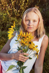 portrait of a beautiful  girl with yellow flowers