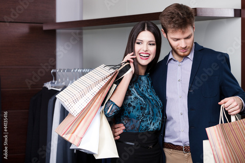 Couple does shopping at the sale shop