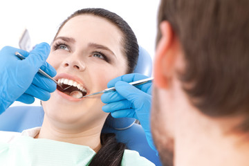 Dentist examines the oral cavity of a patient