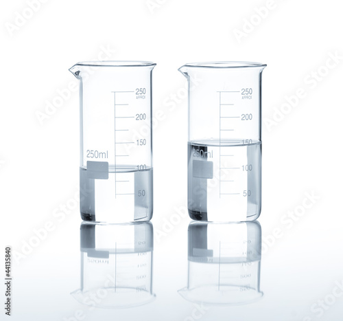 Laboratory flasks with a clear liquid, isolated