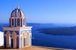 Santorini caldera view with traditional church spire, Greece