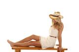 woman bench dress hat