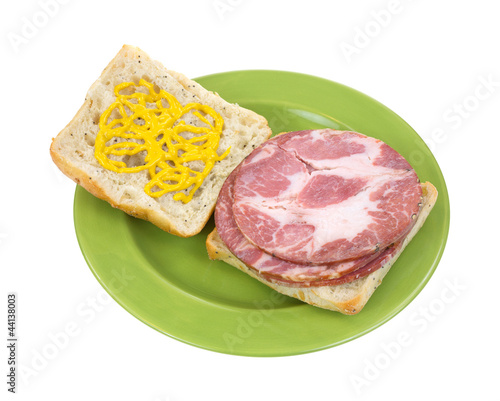 Open faced capicolla sandwich with mustard