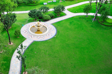 overlook panoramic of lawn with fountain.