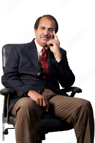 happy, confident senior businessman sitting in the office chair