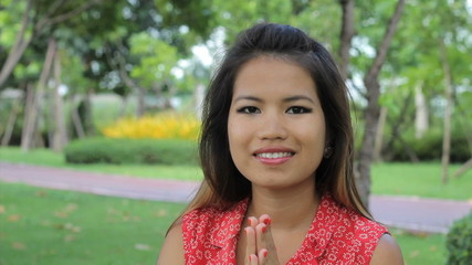 Attractive Asian Girl Doing A Thai Greeting