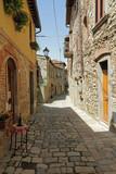 narrow stony street in tuscan borgo Montefioralle - 44146078