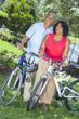 Senior African American Woman & Man Couple Riding Bikes - 44148439