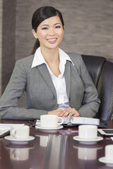 Asian Chinese Woman or Businesswoman in Boardroom