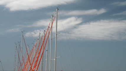Yacht Masts swaying gently against a blue sky