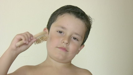 Child brushing his hair