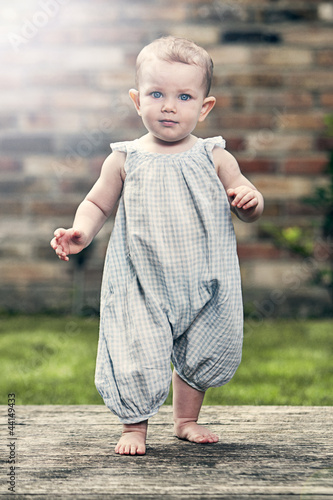 Pretty Baby Girl in Blue Jumpsuit