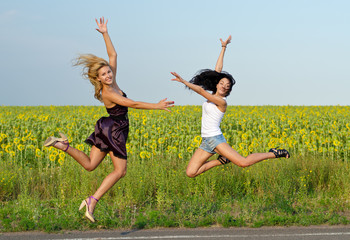Two women leaping for joy