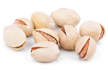 Salted pistachios isolated on white