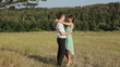 Young couple hugging on the yellow grass