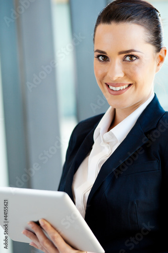beautiful young businesswoman with tablet computer in office