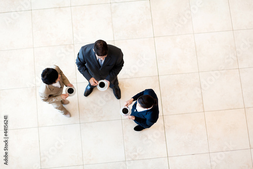 group of co-workers having coffee break at work
