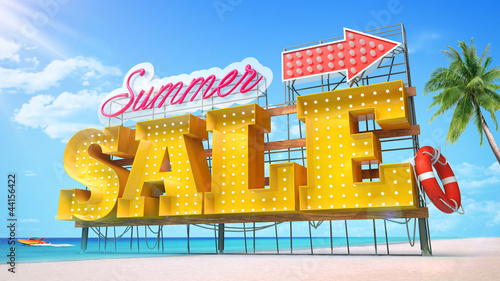 Summer sale. Yellow large-scale letters standing at the beach