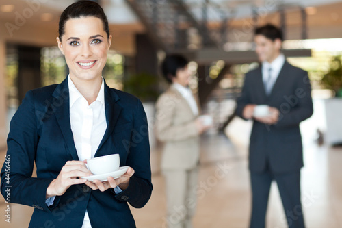 beautiful young businesswoman having coffee break